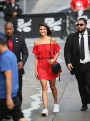 Nina Dobrev accessorized with a simple black shoulder bag.