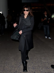 Noomi Rapace looked tough in her black motorcycle boots as she arrived on a flight at LAX.