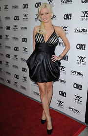 Holly showed off a draped cocktail dress, which she paired with patent leather platform pumps.