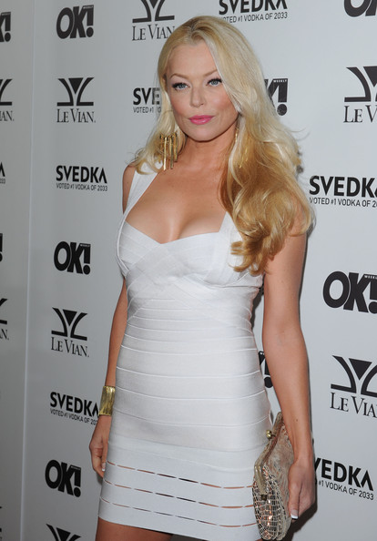 Charlotte showed off her radiant blond locks while hitting the OK! Magazine party.