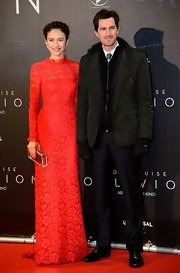 Olga Kurylenko chose a floor-length lace gown with a ruffled collar for her look at the 'Oblivion' premiere in Vienna.