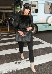 Olivia Culpo punctuated her black look with nude ankle boots.