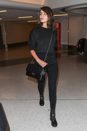 Olivia Culpo finished off her all-black look with a pair of combat boots.