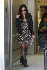 Olivia Munn contrasted her girly dress with a tough-looking black leather jacket.