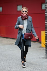 Olivia Palermo walked her dog looking stylish in a gray Whistles coat and black leather skinnies.