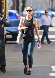 Olivia Wilde stepped out in LA looking sporty in a black tank top and blue leggings.