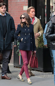 Olivia Palermo was spotted out and about in a air of red leather leggings and wool military-inspired coat.