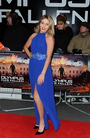 Lydia Rose Bright chose an elegant electric blue evening gown with a floral embellished waist for her red carpet look at the London premiere of 'Olympus Has Fallen.'