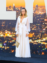 Margot Robbie was boho-glam in a white Chanel Couture gown with a deep-V neckline and blouson sleeves at the LA premiere of 'Once Upon a Time in Hollywood.'