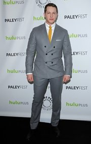 Josh Dallas opted for a snazzy gray suit and yellow tie for his appearance at PaleyFest.