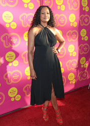Garcelle Beauvais injected some color with a pair of strappy scarlet heels.