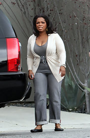 Oprah Winfrey was dressed down in a white cardigan, a gray top, and jeans for a lunch date with Gayle King.