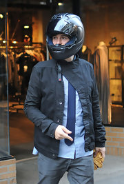 Orlando wore a denim button up jacket while taking a ride with his supermodel girlfriend.