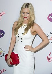 Laura Whitmore dressed up her simple white sheath with a bright red snakeskin lips clutch when she attended the pre-Wimbledon party.