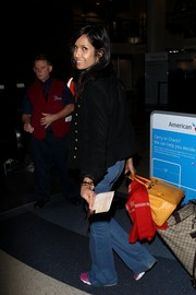Padma Lakshmi made her way through LAX lugging a chic orange ostrich leather Birkin.
