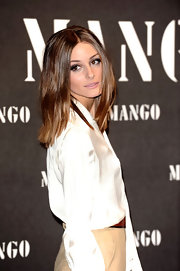 Olivia Palermo showed off her two-toned shoulder length locks while attending the Mango Fashion Show. Her center part locks perfectly shaped her face.