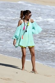 Olivia looked like she was on a photo shoot in this gauzy mint cover-up with bare shoulders at the beach.