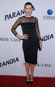 Embeth Davidtz showed off her slim figure with this sheer long-sleeve LBD.