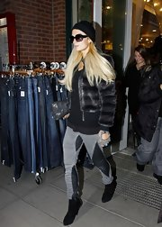 Paris Hilton shopped in style in black suede ankle boots.