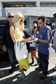 Paris Hilton signed some autographs in Sydney while wearing a pair of pretty sky blue pumps.
