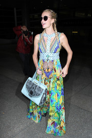Paris Hilton brought a vibrant burst of color to LAX with this printed maxi dress.