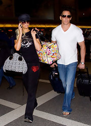 Cy Waits wore a simple white tee, with v-neck collar, while traveling with girlfriend Paris Hilton.