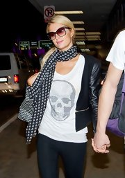 Paris' patterned scarf added graphic definition to her look.