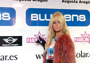 Paris Hilton wore her hair long and wavy with the addition of eye-enhancing, lash grazing bangs at the unveiling of the new BMW 6 Series Coupe and Mini Coupe.