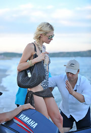 Paris Hilton showed off her gold bangle bracelet while leaving the beach.