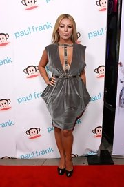 Aubrey O'Day is never one for subtlety. At the Paul Frank Fashion's Night Out event the daring gal opted to wear a deep-plunging velvet dress.