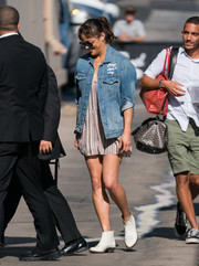 Paula Patton layered a denim jacket over a striped romper for her visit to 'Kimmel.'