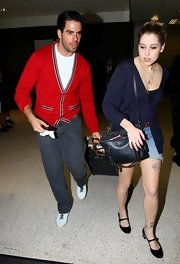 Eli Roth looked downright adorable in a preppy red cardigan.