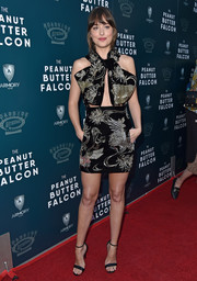 Dakota Johnson rocked an elegantly embroidered black cutout dress by Saint Laurent at the premiere of 'The Peanut Butter Falcon.'