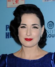 At Perez Hilton's Birthday Party, Dita Von Teese wore her tresses swept to the side with hair ends tightly curled and pinned into place.