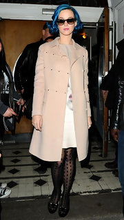 Katy Perry kept her look unexpectedly prim with a blush wool jacket.