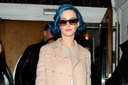 Katy Perry gives a wave and a smile as she leaves BBC Radio 1 after pre-recording an episode of