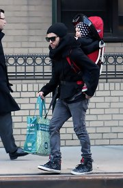 Pete paired his trendy high top sneakers with grey skinny jeans.
