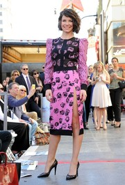 Evangeline Lilly brought a bright pop to Peter Jackson's Walk of Fame ceremony with this pink and black rose-print dress by Emanuel Ungaro.