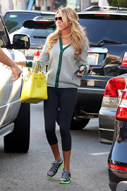 Petra Ecclestone looked sporty in LA wearing leggings and a green-trimmed cardigan.