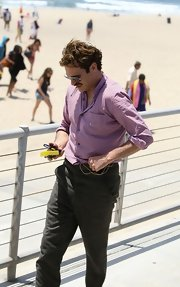 Joaquin goes preppy by the beach in a check button-down shirt.