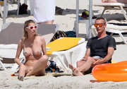 White framed square sunglasses were a fashionable look for Beatrice Borromeo's day on the beach.