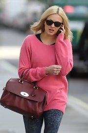 Fearne Cotton carried this maroon leather tote with her eclectic outfit while heading to work.
