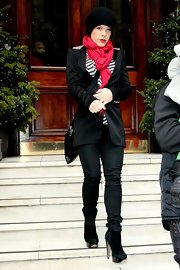 Pink looked all dressed up for winter in a pair of skinny jeans and a bright, bold scarf.
