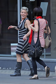 The singer kept it casual in a striped jersey dress with tall leather, buckled boots.