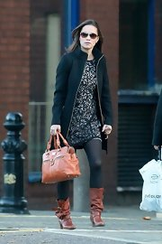 Pippa Middleton was chic for work with a black lace dress paired with tan slouchy brown boots complete with buckled detailing.