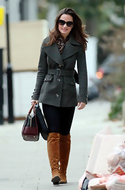 Pippa Middleton bundled up in a belted wool coat and cognac knee-high boots.