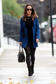 Pippa topped off her cool fall ensemble with black suede ankle boots complete with side lace-up detailing.