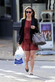 Pippa opted for a chic red dress for work that she paired with a brown croc leather bag in her fav 'Pippa' style.