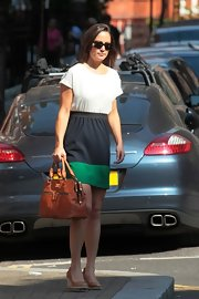 Pippa wore a budget-friendly tri-tone Zara dress around Chelsea paired with a Modalu bag and summery tan wedges.