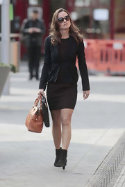 Pippa opted for a chic look for work. She paired her black blazer with black suede ankle boots.